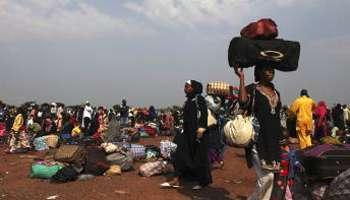 Des Centrafricains fuient la guerre. Crédit photo: www.jeuneafrique.com